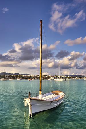 colom: boat in porto colom bay in majorca, spain