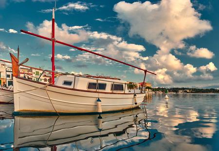 colom: boat and porto colom bay in  balearic islands Stock Photo