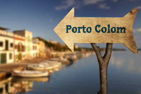 colom: wooden sign indicating the direction of Porto Colom in Majorca