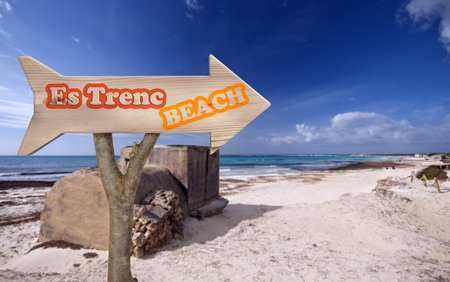 es: trunk and wooden sign indicating to es trenc beach