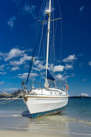 aground: boat aground on the beach pollensa