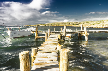 wooden dock: llaut on wooden dock in menorca Stock Photo