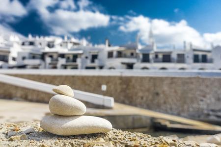 menorca: binibeca traditional fishing village in Menorca and zen stones