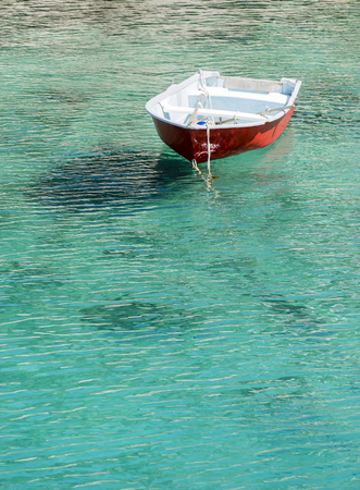 Barca floating in transparent water in mallorca