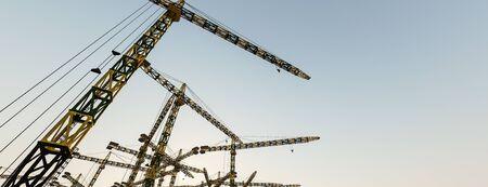 3d illustration of construction cranes