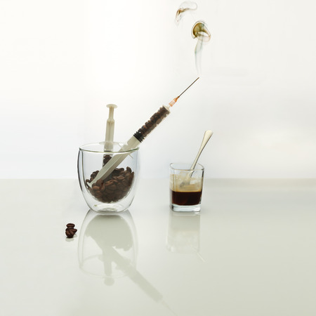 artistic addiction: Coffee intravenous drug. Coffee Beans in plastic syringe.