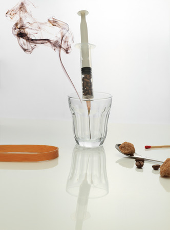 injectable: Coffee intravenous drug. Coffee Beans in plastic syringe