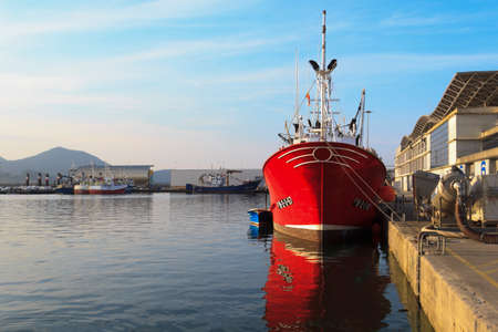 Fishing boats moored in the port of Santoña, famous for anchovy fishing Reklamní fotografie