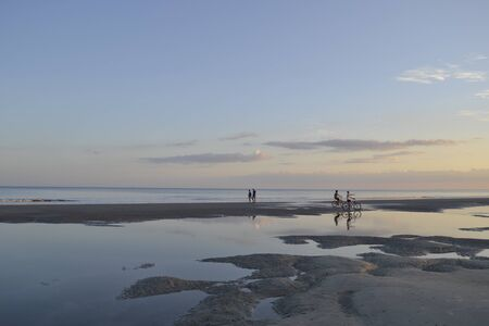 People doing sports at Hilton Head Beach with mudflat