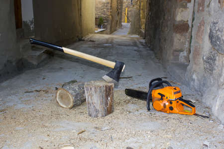 Ax and chainsaw, firewood tools for cutting photo