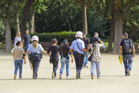 BARCELONA - OCTOBER 15: Police arrested youths in the park of the Ciudadela. October 15, 2011 in Barcelona (Spain).