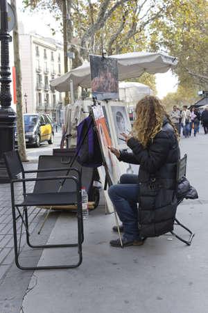 manos: BARCELONA - NOVEMBER 07: Painters in the street of the Las Ramblas Barcelona on nov 7TH 2011 in Barcelona, Spain