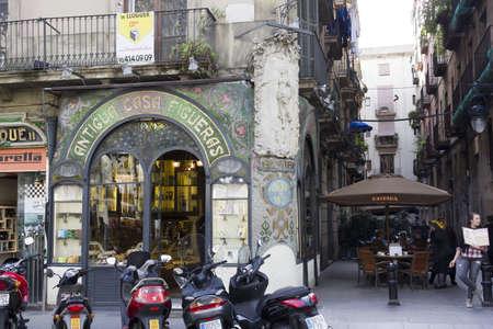 BARCELONA - NOVEMBER 07: Tourists and souvenir kiosks in the Ramblas of Barcelona on nov 7TH 2011 in Barcelona, Spain