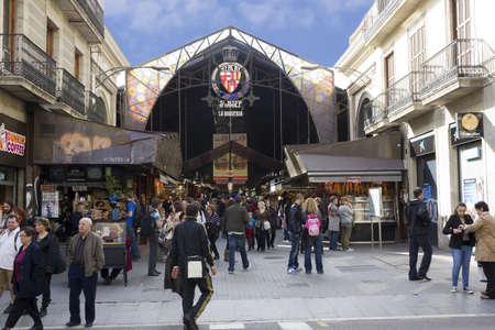 BARCELONA - NOVEMBER 07: Tourists visit the Boqueria market on nov 7TH 2011 in Barcelona, Spain