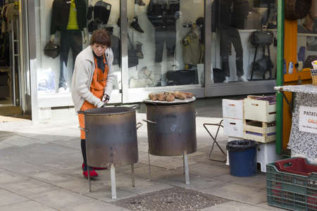 BARCELONA - NOVEMBER 07: A mature woman chestnut roasters on nov 7TH 2011 in Barcelona, Spain