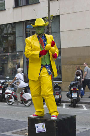 BARCELONA - NOVEMBER 07: Human figures are typical of Las Las Ramblas Barcelona on nov 7TH 2011 in Barcelona, Spain