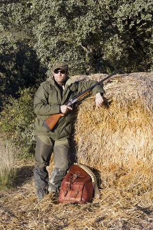 Man hunting in the field with an old shotgun Stock Photo