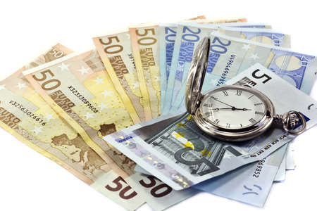 Euro banknotes and antique clock, isolated on white background