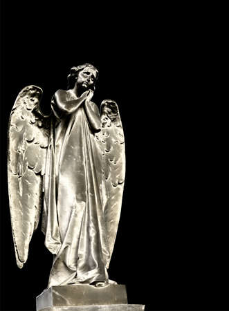 Statue of an angel in the cemetery photo
