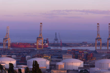 Port of goods from Barcelona at sunset