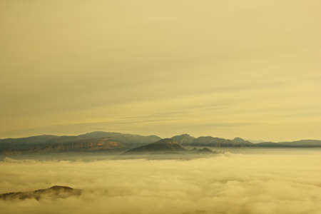 Mountain landscape in the mist of the morning photo