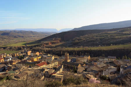 An old stone village between the mountains and blue sky photo