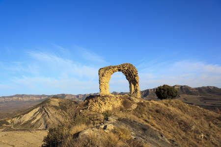 Ruins of an old medieval church. Entrance arch Stock Photo - 12844500