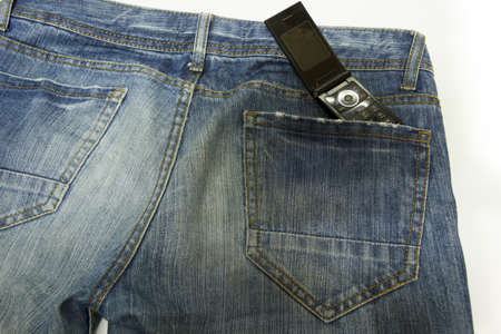Very closely in foreground the back of jeans, with phone in the pocket photo