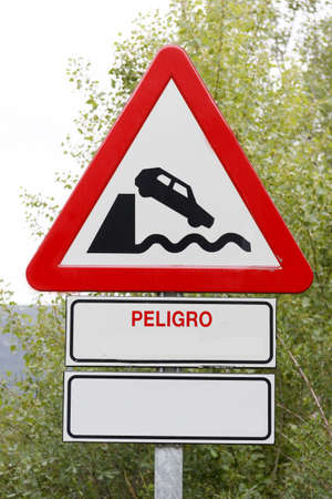 Warning Sign by drop to the river Stock Photo - 14618399