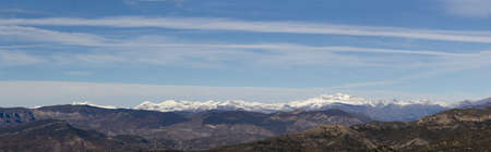 Panoramic view of the high mountains of the Pyrenees and first snow of the season photo