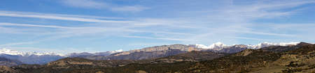 Panoramic view of the high mountains of the Pyrenees and first snow of the season