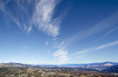 Vertical Panoramic Photography of sky and a cloud over some mountains in the background photo