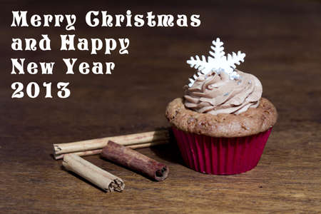Christmas Cards and cook cakes  Delicious dessert of cupcakes photo