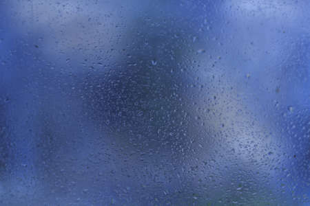 Water droplets on glass  Background for their your computer, smartphone, as background or texture in your projects photo