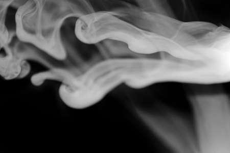 White smoke against deep black background Stock Photo - 18963405