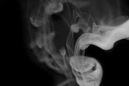White smoke against deep black background Stock Photo - 18963419