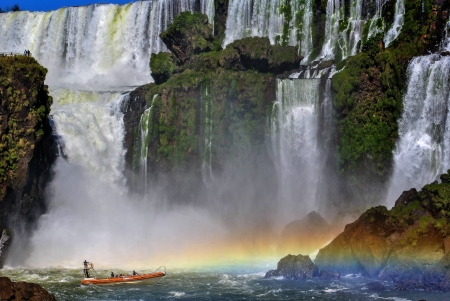 Boating on the Iguassu River, at the foot of the falls, one of the seven wonders of the modern world, in Argentina, South America
