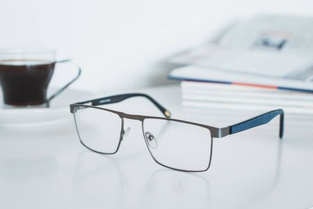 Glasses with book and coffee