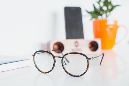Glasses with phone and plant