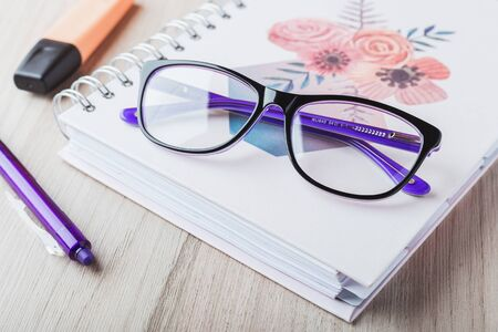 Woman glasses with planner and pencils Stok Fotoğraf