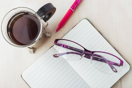 Woman glasses with notebook, coffee and pencil