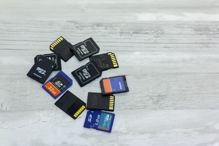 Some memory cards on a white marbled table