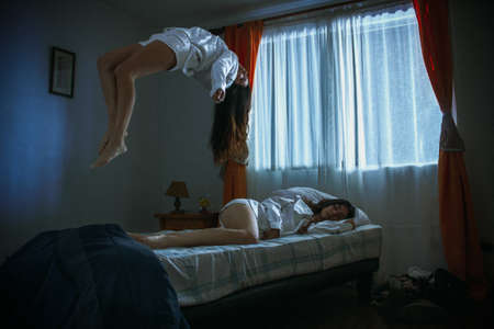 Woman unfolding in her room