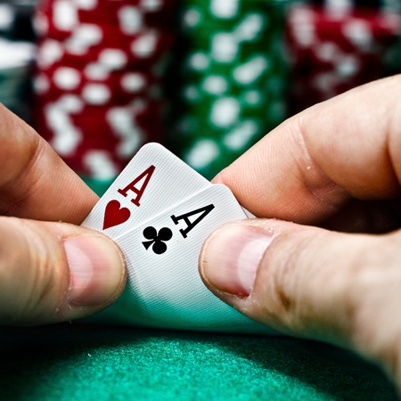 hands with a pair of aces
