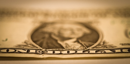 one dollar bill with focus in the