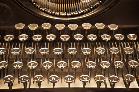 Part of an antique manual Underwood typewriter on sepia
