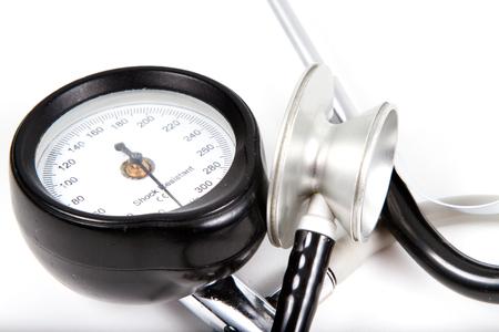 Sphygmomanometer and medical stethoscope, isolated on white background.