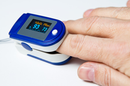 A pulse oximeter used to measure pulse rate and oxygen levels Reklamní fotografie - 67173679