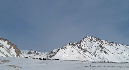 snowy peaks in the Andes Mountains. mountain villages, ski resorts in Argentina, hidden routes. beautiful landscapes