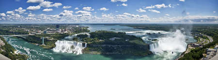 horseshoe falls: Panoramic aerial view of Niagara Falls, including Canadian and American Falls, Rainbow Bridge, the American frontier, the city of Niagara Falls and the boats of the Maid of the Mist